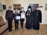 Правящий архиерей Валуйской епархии вручил денежный сертификат семье на лечение ребенка
