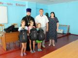 Настоятель Свято-Троицкого собора поселка Ровеньки принял участие в благотворительной акции «Вместе в школу детей соберём!»